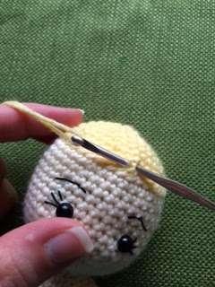 attaching hair to crochet doll